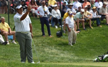 Kiradech Aphibarnrat tries to talk an eagle putt into falling. He went on to birdie the hole.