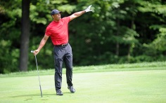 Tiger Woods warns the gallery around the 15th green that his ball is headed toward them.