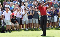 Tiger Woods tees off on No. 16.