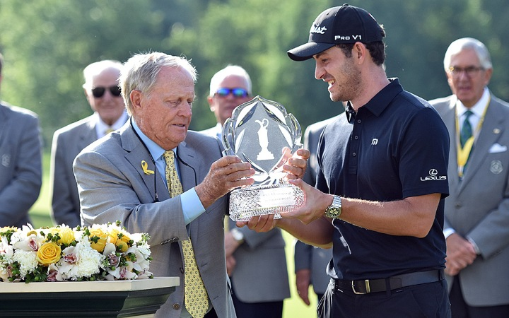 Jack Nicklaus gives Patrick Cantlay the Memorial trophy.